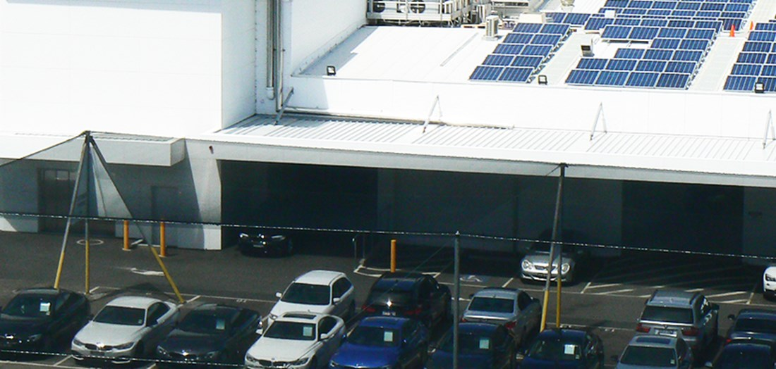 Car dealership with solar panels on roof